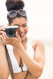 Pretty hipster in bikini taking picture Royalty Free Stock Photos