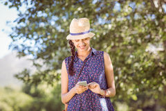 Pretty hipster checking her phone Stock Image