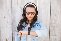 Pretty hipster checking the time Royalty Free Stock Photos