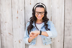Pretty hipster checking the time Stock Photo