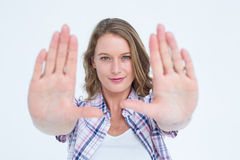 Pretty hipster doing frame with her hands Royalty Free Stock Photo