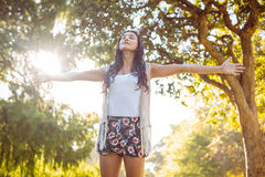 Pretty hipster felling free in the park Stock Images