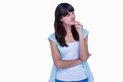 Pretty hipster with finger on chin looking away Stock Image