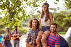 Pretty hipster on friends shoulders Royalty Free Stock Images
