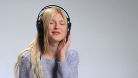 Pretty hipster girl going crazy of favorite music stock video footage