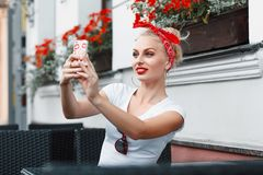 Pretty hipster girl taking a `selfie`. Vintage portrait. Pretty hipster girl taking a `selfie Royalty Free Stock Image
