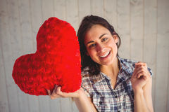 Pretty hipster holding heart pillow Royalty Free Stock Photos