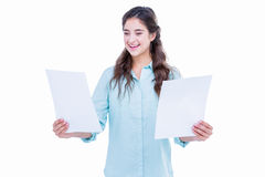 Pretty hipster holding sheets of paper Royalty Free Stock Photos