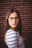 Pretty hipster looking at camera stock photography