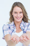 Pretty hipster presenting her hands Stock Photo