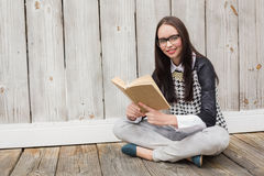 Pretty hipster reading a book Stock Photo