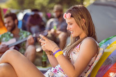 Pretty hipster sending text message Royalty Free Stock Photos