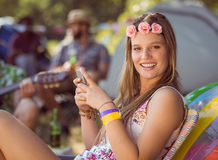 Pretty hipster sending text message Stock Photography