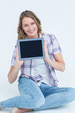 Pretty hipster showing her tablet Stock Photo