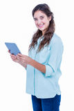 Pretty hipster smiling at camera and holding tablet Royalty Free Stock Photos