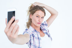 Pretty hipster taking selfie with smartphone Stock Photo