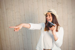 Pretty hipster using her vintage camera Royalty Free Stock Photo