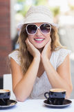 Pretty hipster woman at the cafe terrace Stock Photography