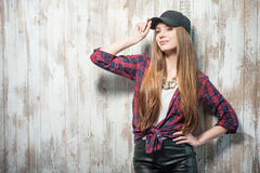 Pretty hipster woman with hat is standing near the Royalty Free Stock Photos