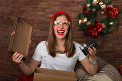 Pretty hipster woman opening Christmas presents Stock Images