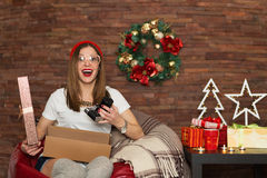 Pretty hipster woman opening Christmas presents Royalty Free Stock Images