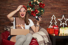 Pretty hipster woman opening Christmas presents Royalty Free Stock Photography