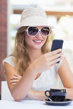 Pretty hipster woman sending a text Stock Photography