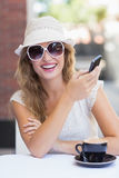 Pretty hipster woman sending a text Stock Photos