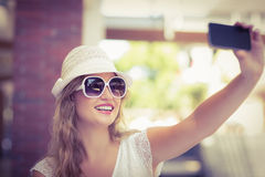 Pretty hipster woman taking a selfie Stock Images