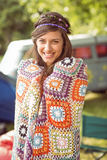 Pretty hipster wrapped in crotchet blanket Royalty Free Stock Image