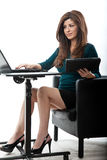 Working in the office. Pretty hispanic businesswoman in her forties Royalty Free Stock Images