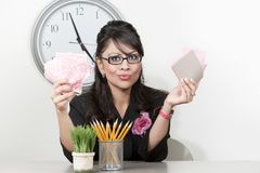 Pretty Hispanic businesswoman with too much to do Royalty Free Stock Photo