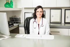 Pretty Hispanic female doctor in an office Royalty Free Stock Image