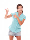 Pretty hispanic female pointing to her right Stock Image