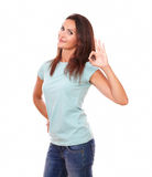 Pretty hispanic female with positive gesture Royalty Free Stock Image