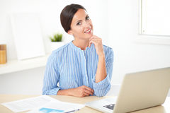 Pretty hispanic female studying on her desk Stock Photography