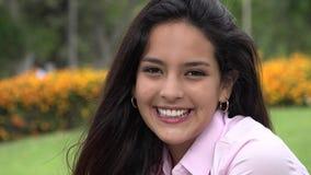 Pretty hispanic female teen smiling