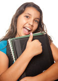 Pretty Hispanic Girl with Books and Backpack stock photo