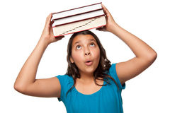 Pretty Hispanic Girl with Books on Her Head Royalty Free Stock Photography