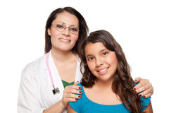 Pretty Hispanic Girl and Female Doctor Royalty Free Stock Photos