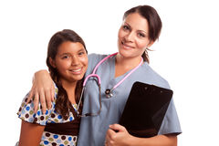 Pretty Hispanic Girl and Female Doctor Isolated Royalty Free Stock Photos