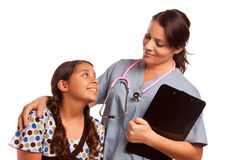 Pretty Hispanic Girl and Female Doctor Isolated Stock Photography