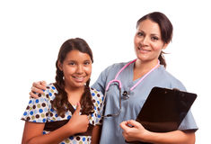 Pretty Hispanic Girl and Female Doctor Isolated Royalty Free Stock Images