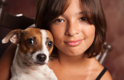Pretty Hispanic Girl and Her Puppy Studio Portrait royalty free stock photography