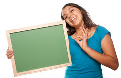 Pretty Hispanic Girl Holding Blank Chalkboard. Isolated on a White Background Stock Photos