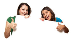 Pretty Hispanic Girl and Mother Holding Board stock image