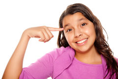 Pretty Hispanic Girl Pointing to Her Head Stock Images