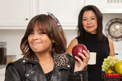 Pretty Hispanic Girl Ready for School with Mom Stock Photo