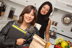 Pretty Hispanic Girl Ready for School with Mom Stock Images