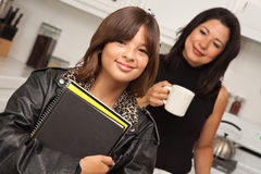 Pretty Hispanic Girl Ready for School with Mom Royalty Free Stock Images